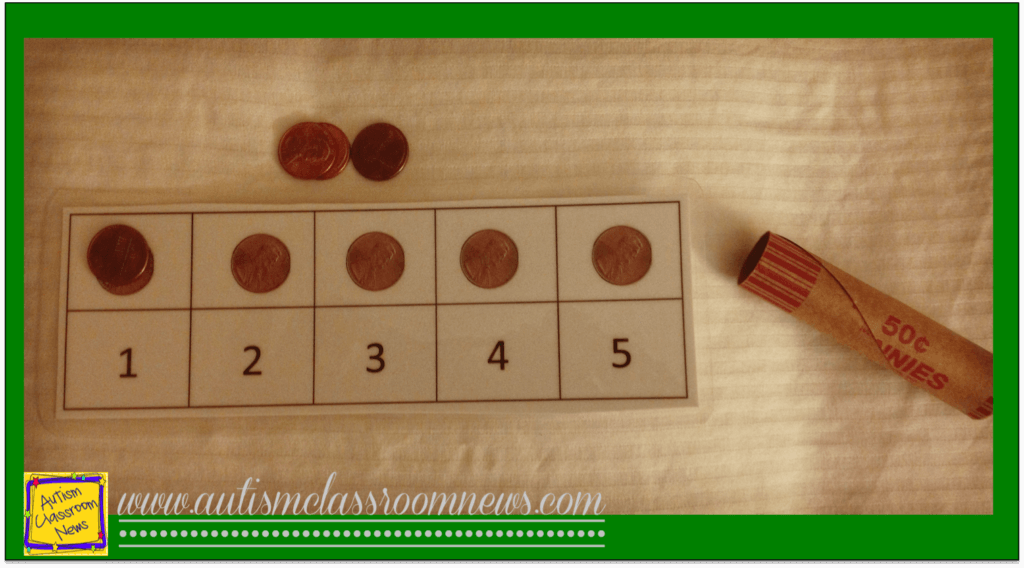 This picture is a jig for laying out 5 pennies and then putting them in a roll of pennies as part of a structured work system for students with autism